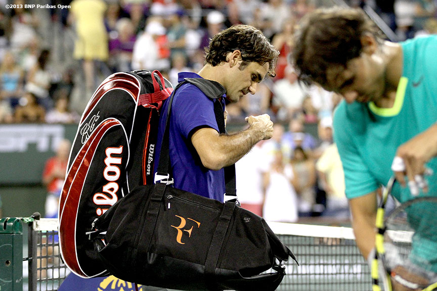 """Roger Federer walks off the court after losing to Rafael Nadal Thursday, March 14, 2013 at the BNP Paribas Open in Indian Wells, California."""