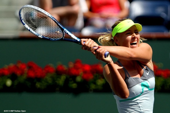 """Maria Sharapova hits a backhand during the BNP Paribas Open championship match against Caroline Wozniacki Sunday, March 18, 2013 in Indian Wells, California."""