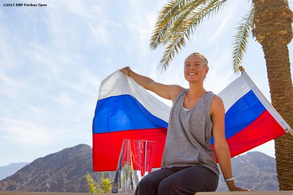 """Maria Sharapova poses for a championship photograph after winning the BNP Paribas Open Sunday, March 18, 2013 in Indian Wells, California."""