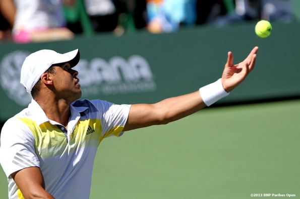 """Jo-Wilfried Tsonga serves during his match against Milos Raonic Wednesday, March 13, 2013 at the BNP Paribas Open in Indian Wells, California."""