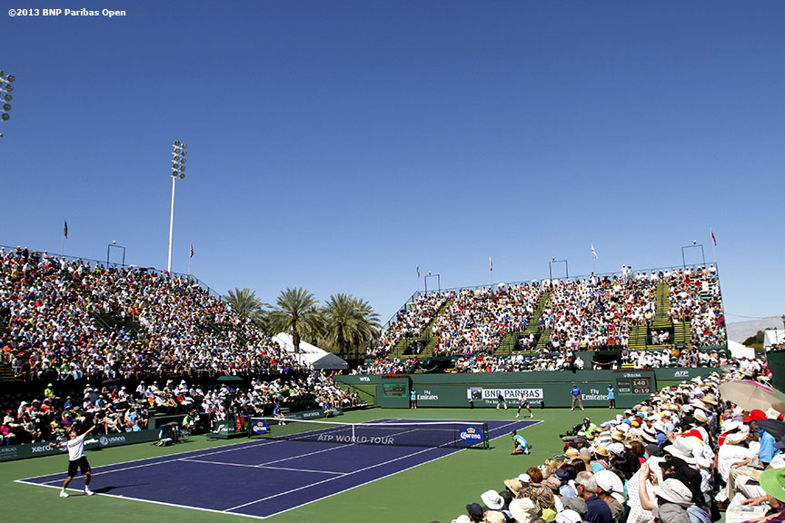 """Milos Raonic serves to Jo-Wilfried Tsonga Wednesday, March 13, 2013 at the BNP Paribas Open in Indian Wells, California."""
