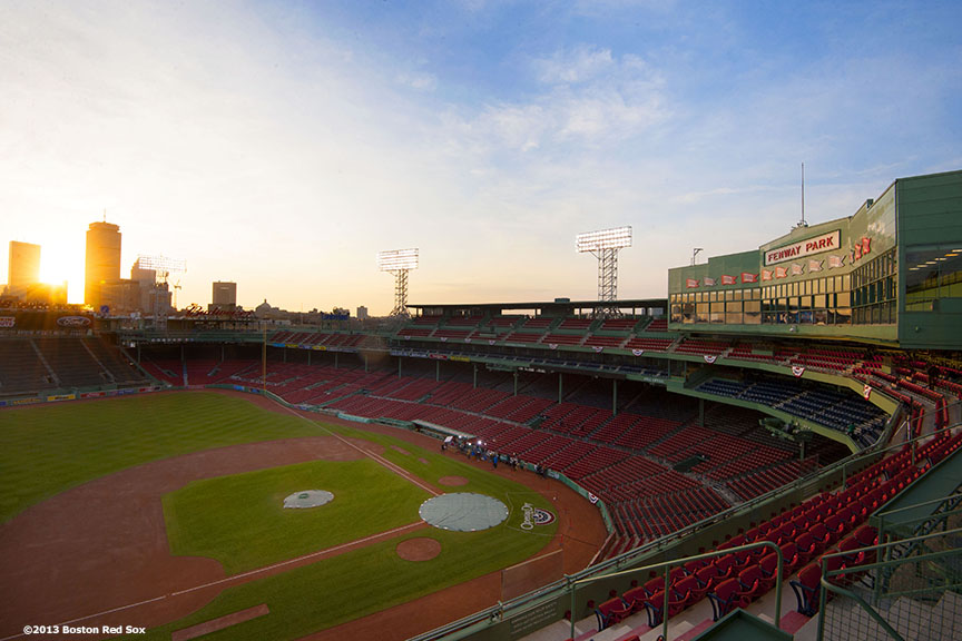 """The sun rises over Fenway Park before the Boston Red Sox 2013 home opener Monday, April 8, 2013."""