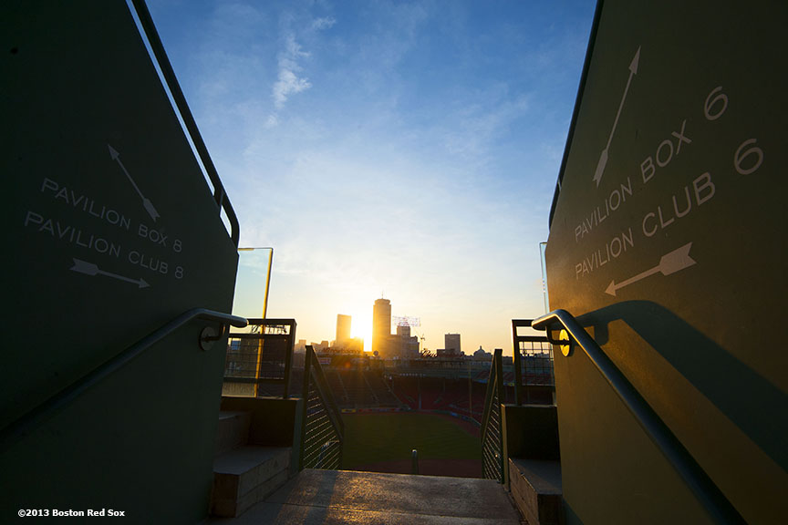 """""""The sun rises over Fenway Park before the Boston Red Sox 2013 home opener Monday, April 8, 2013."""""""