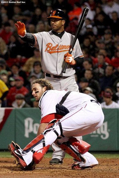 """Boston Red Sox catcher Jarrod Saltalamacchia blocks a wild pitch during the third inning of a game against the Baltimore Orioles Thursday, April 11, 2013 at Fenway Park in Boston, Massachusetts."""