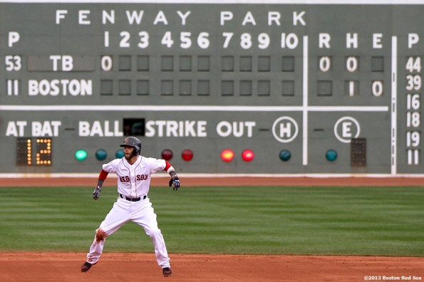 """Boston Red Sox second baseman Dustin Pedroia takes a lead during the first inning of a game against the Tampa Bay Rays Sunday, April 14, 2013 at Fenway Park in Boston, Massachusetts."""