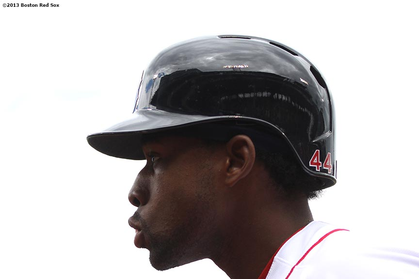 """""""Boston Red Sox outfielder Jackie Bradley Jr. walks toward the on-deck circle during the third inning of a game against the Tampa Bay Rays Sunday, April 14, 2013 at Fenway Park in Boston, Massachusetts."""""""