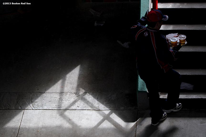 """A fan walks up stairs in the Big Concourse at Fenway Park in Boston, Massachusetts Sunday, April 14, 2013."""