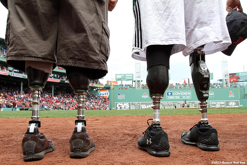 """Members of the Achilles Freedom Team of Wounded Veterans await an honorary pre-game ceremony Sunday, April 14, 2013 at Fenway Park in Boston, Massachusetts."""