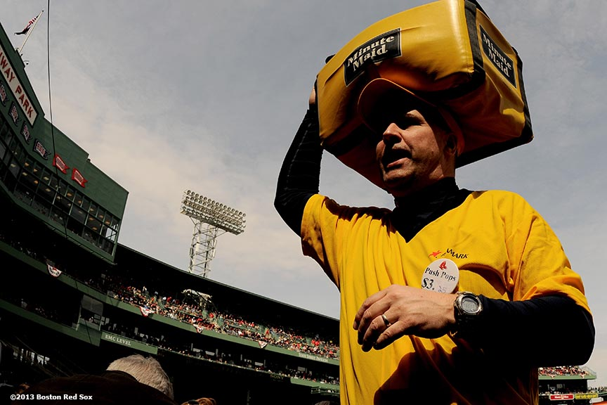 """A vendor sells lemonade during a game between the Boston Red Sox and the Tampa Bay Rays Monday, April 15, 2013 at Fenway Park in Boston, Massachusetts."""