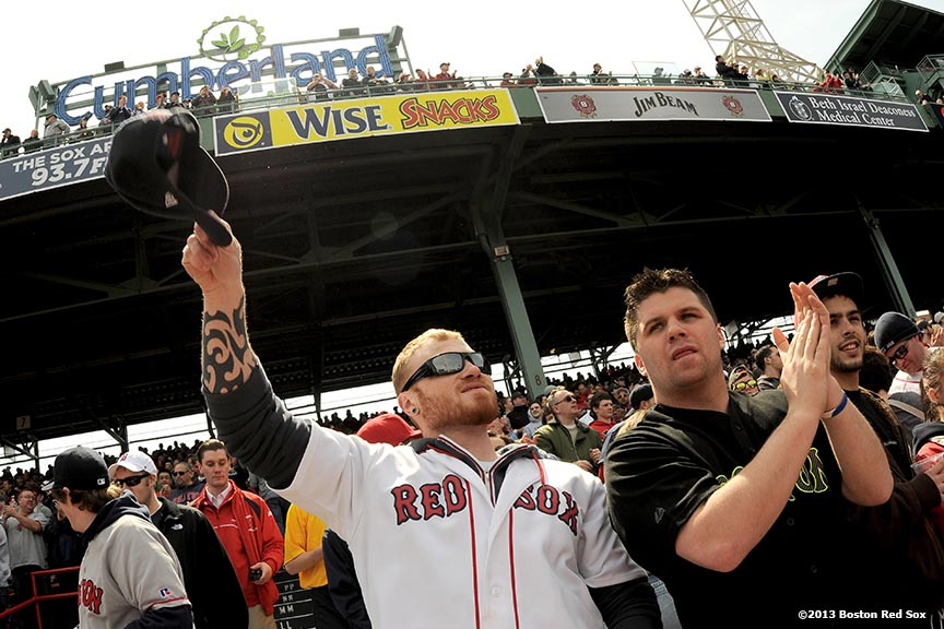 """Fans cheer during a game between the Boston Red Sox and the Tampa Bay Rays Monday, April 15, 2013 at Fenway Park in Boston, Massachusetts."""