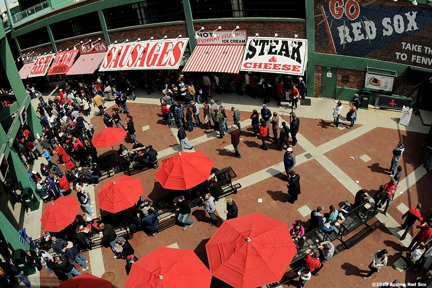 """Fans crowd the Gate B food court at Fenway Park in Boston, Massachusetts during a game between the Boston Red Sox and the Tampa Bay Rays Monday, April 15, 2013."""
