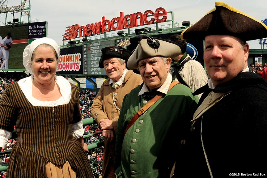 """Members of the End Zone Militia pose for a photograph during a game between the Boston Red Sox and the Tampa Bay Rays at Fenway Park in Boston, Massachusetts Monday, April 15, 2013."""