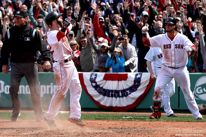 """Boston Red Sox second baseman Dustin Pedroia celebrates after scoring on a walk-off RBI double by first baseman Mike Napoli to defeat the Tampa Bay Rays 3-2 in the bottom of the ninth inning Monday, April 16, 2013 at Fenway Park in Boston, Massachusetts."""