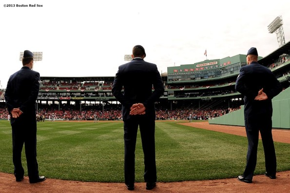 """Members of the United States Air Force stand in left field at Fenway Park in Boston, Massachusetts Monday, April 15, 2013 before a pre-game ceremony recognizing Patriot's Day."""