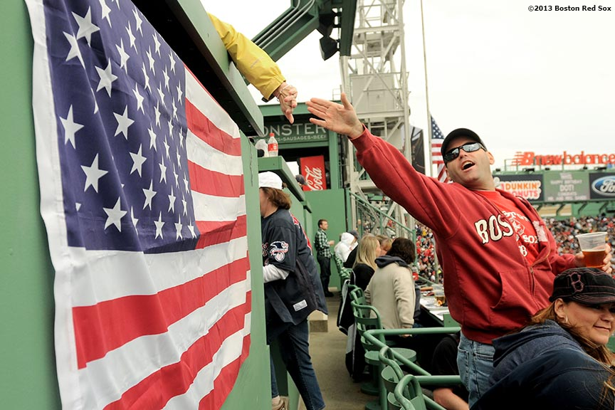 """Fans greet each other in the Green Monster Seats during the first Boston Red Sox home game after the attacks on the 2013 Boston Marathon Saturday, April 20, 2013."""