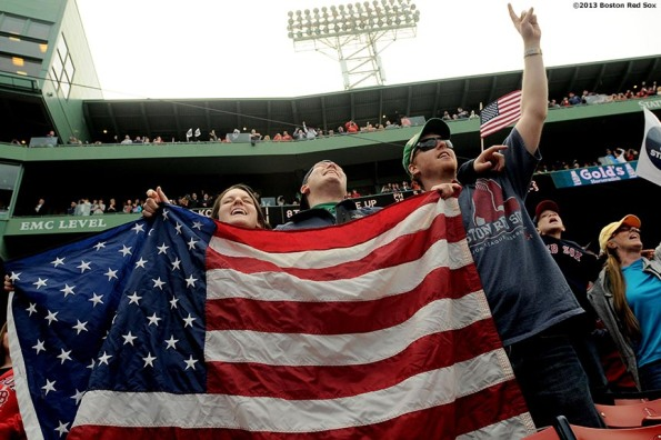 """Fans sing along to 'Sweet Caroline' during the first Boston Red Sox home game after the attacks on the 2013 Boston Marathon Saturday, April 20, 2013."""