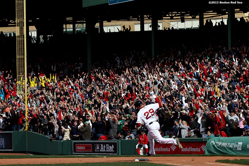 """Boston Red Sox outfielder Daniel Nava celebrates as he rounds the bases after hitting the game-winning 3-run home run during the eighth inning of a game against the Kansas City Royals Saturday, April 20, 2013. It was the first Red Sox home game since the attacks on the 2013 Boston Marathon."""