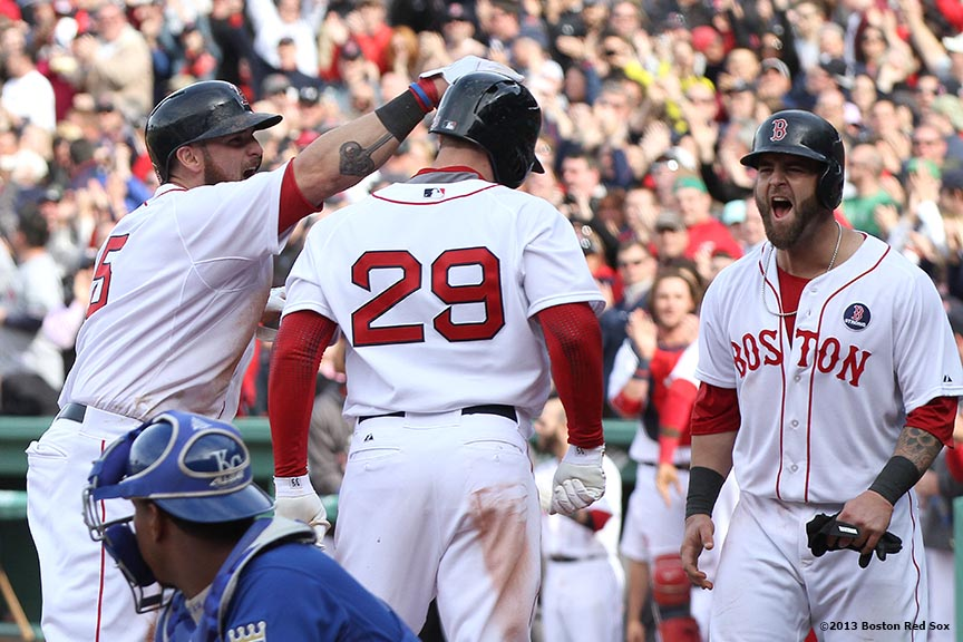 """Boston Red Sox outfielder Daniel Nava celebrates with Jonny Gomes and Mike Napoli after hitting the game-winning 3-run home run during the eighth inning of a game against the Kansas City Royals Saturday, April 20, 2013. It was the first Red Sox home game since the attacks on the 2013 Boston Marathon."""