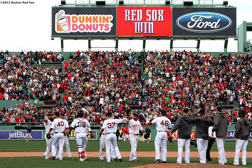"""The Boston Red Sox congratulate each other after defeating the Kansas City Royals Saturday, April 20, 2013. It was the first Red Sox home game since the attacks on the 2013 Boston Marathon."""