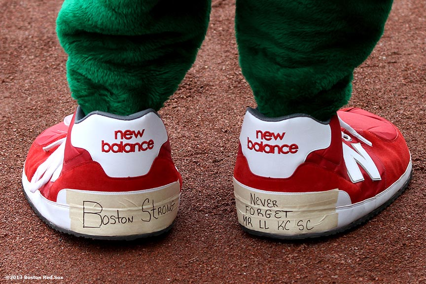 """Wally the Green Monster mascot shows his Boston Strong shoes during the first Boston Red Sox home game after the attacks on the 2013 Boston Marathon Saturday, April 20, 2013."""