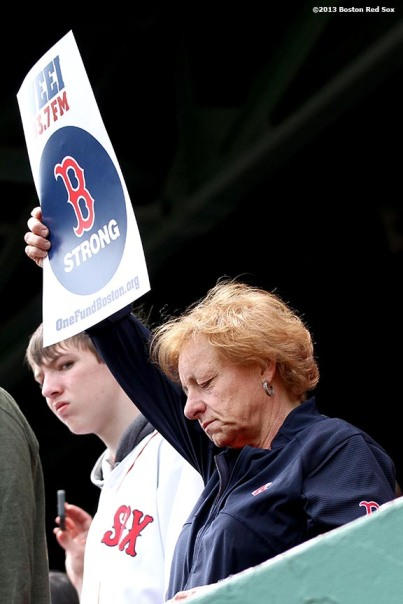 """A fan holds a Boston Strong sign during a pre-game ceremony honoring the victims, first responders, and others involved in the attacks on the 2013 Boston Marathon Saturday, April 20, 2013."""