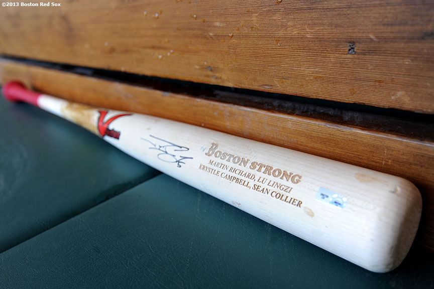 """The bat of Boston Red Sox outfielder Jonny Gomes is shown in the dugout at Fenway Park Monday, April 21, 2013 engraved with the words 'Boston Strong' and the names of the four victims killed in the bombings at the 2013 Boston Marathon."""