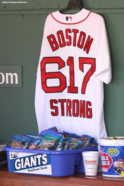 """A 'Boston Strong' jersey is hung in the Boston Red Sox dugout at Fenway Park Sunday, April 21, 2013 in honor of the attacks on the 2013 Boston Marathon."""
