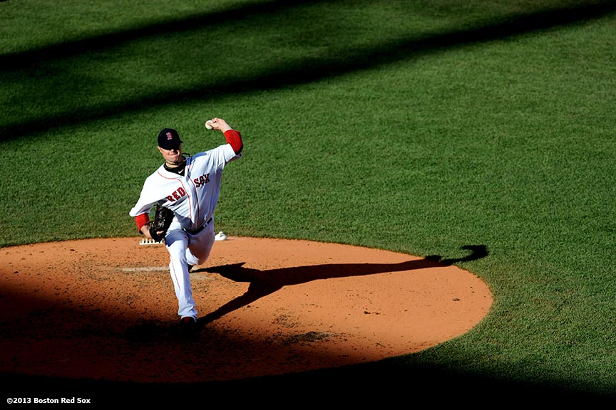 """Boston Red Sox pitcher Jon Lester delivers during the sixth inning of a game against the Oakland Athletics Wednesday, April 24, 2013 at Fenway Park in Boston, Massachusetts."""