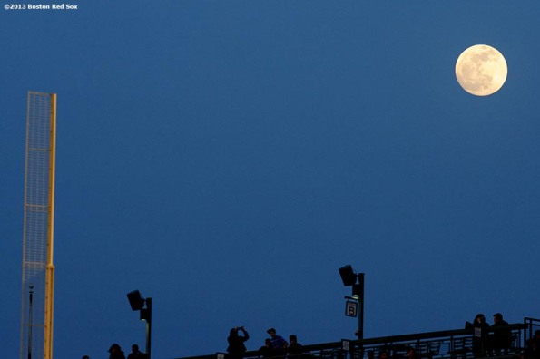 """A full moon is shown over Fenway Park in Boston, Massachusetts Wednesday, April 24, 2013 during a game between the Boston Red Sox and the Oakland Athletics."""