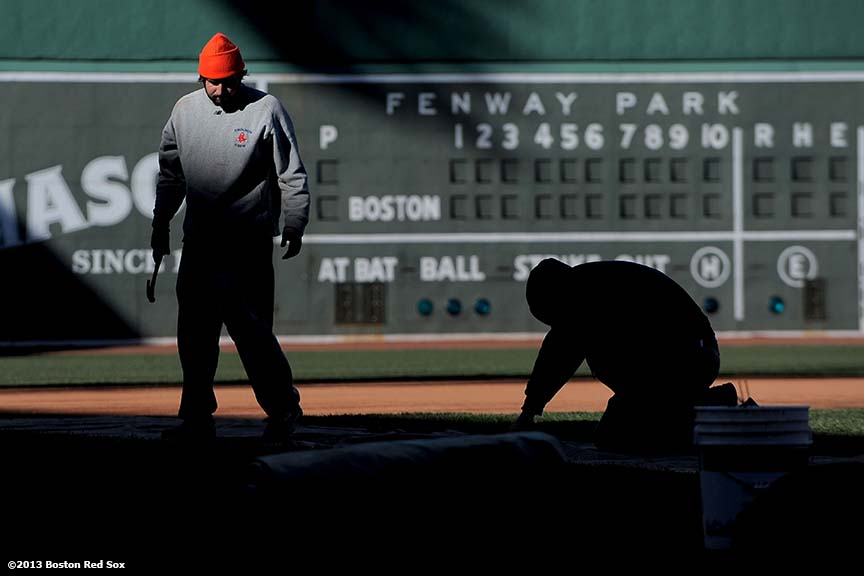 """Members of the Fenway Park grounds crew prepare the field before the 2013 Boston Red Sox home opener Tuesday, March 26, 2013."""