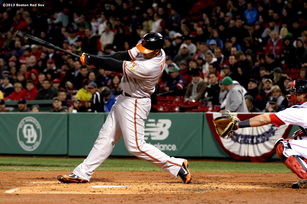 """Baltimore Orioles first baseman Chris Davis hits his sixth home run of the season during the second inning of a game against the Boston Red Sox Thursday, April 11, 2013 at Fenway Park in Boston, Massachusetts."""