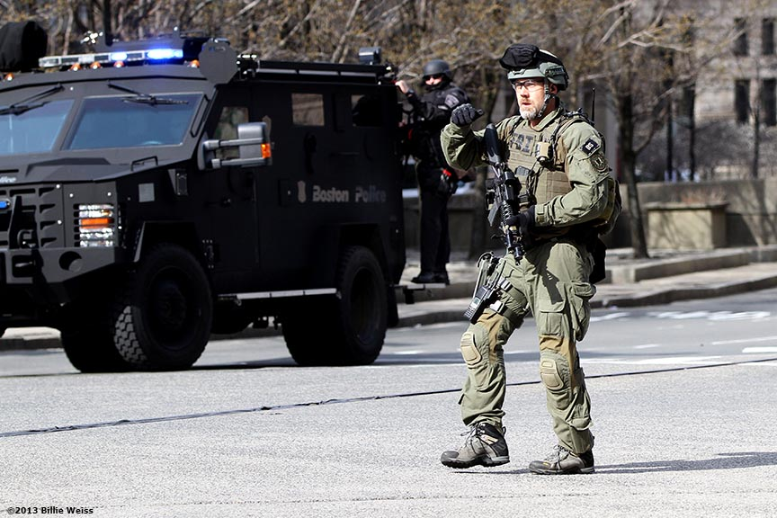 Boston, MA, April 15, 2013:  A Boston SWAT team member walks near the perimeter of Copley Square after two explosions were detonated at the finish line of the 2013 Boston Marathon.  (Photo by Billie Weiss)
