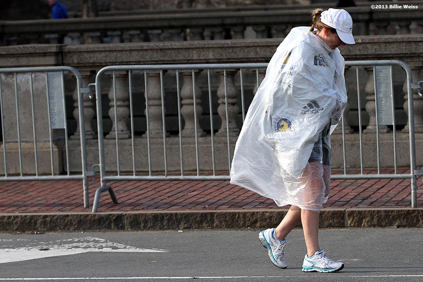 April 15, 2013 - Boston, Massachusetts, United States: A pedestrian walks on Commonwealth Ave near Kenmore Square after two bombs were detonated at the finish line of the 2013 Boston Marathon. (Billie Weiss)