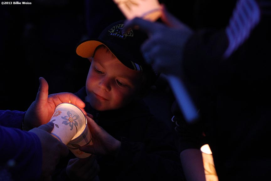 April 16, 2013 - Boston, Massachusetts, United States: Jake Quigley, 7, of Dorchester, Massachusetts has his candle lit during a candlelight vigil at Garvey Park for Martin Richard, 8, who was killed yesterday in a bomb explosion at the finish line of the 2013 Boston Marathon. (Billie Weiss)
