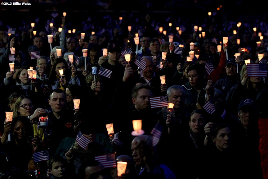 April 16, 2013 - Boston, Massachusetts, United States:  Locals gather in a moment of silence during a candlelight vigil at Garvey Park for Martin Richard, 8, who was killed yesterday in a bomb explosion at the finish line of the 2013 Boston Marathon.(Billie Weiss/Polaris)