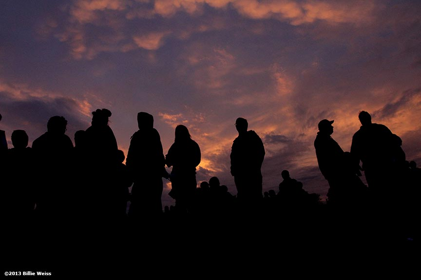 April 16, 2013 - Boston, Massachusetts, United States:  The sun sets as locals await a candlelight vigil at Garvey Park for Martin Richard, 8, who was killed yesterday in a bomb explosion at the finish line of the 2013 Boston Marathon. (Billie Weiss)