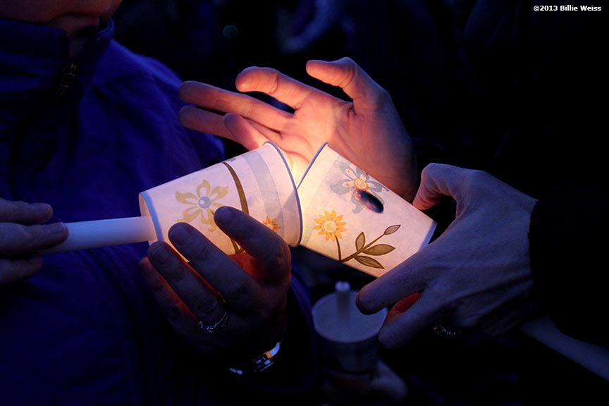 April 16, 2013 - Boston, Massachusetts, United States:  A candle is lit during a candlelight vigil at Garvey Park for Martin Richard, 8, who was killed yesterday in a bomb explosion at the finish line of the 2013 Boston Marathon. (Billie Weiss)
