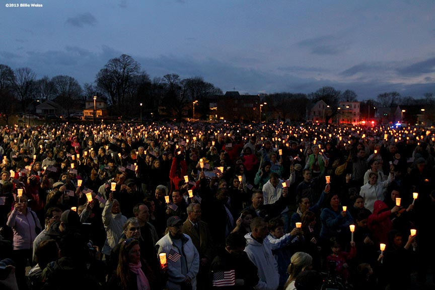 April 16, 2013 - Boston, Massachusetts, United States:  Locals hold up their candles in a moment of silence during a candlelight vigil at Garvey Park for Martin Richard, 8, who was killed yesterday in a bomb explosion at the finish line of the 2013 Boston Marathon.(Billie Weiss)