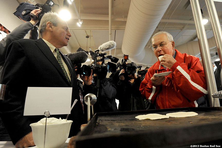 """Larry Lucchino, Boston Red Sox President & CEO, points out new ballpark features to Thomas M. Menino, Mayor of Boston, at Fenway Park Friday, April 5, 2013 during the Mayor's stadium walkthrough before the 2013 Boston Red Sox home opener."""