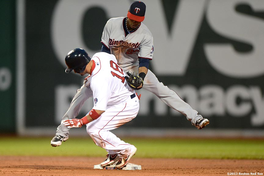 """Boston Red Sox right fielder Shane Victorino slides after stealing second base during the third inning of a game against the Minnesota Twins Thursday, May 9, 2013 at Fenway Park."""