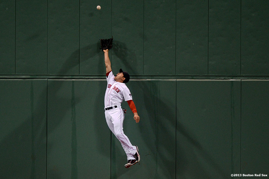 """Boston Red Sox center fielder Jacoby Ellsbury leaps as he attempts to catch a deep fly ball during the fifth inning of a game against the Minnesota Twins Thursday, May 10, 2013 at Fenway Park."""