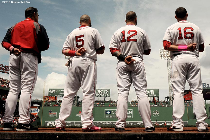 """Boston Red Sox manager John Farrell, outfielder Jonny Gomes, first baseman Mike Napoli, and third baseman Will Middlebrooks, line up in front of the dugout during the National Anthem before a game against the Toronto Blue Jays Sunday, May 12, 2013 at Fenway Park in Boston, Massachusetts."""