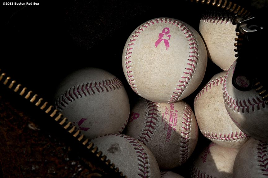 """Pink-laced baseballs are shown in honor of Mother's Day Sunday, May 12, 2013 at Fenway Park in Boston, Massachusetts."""