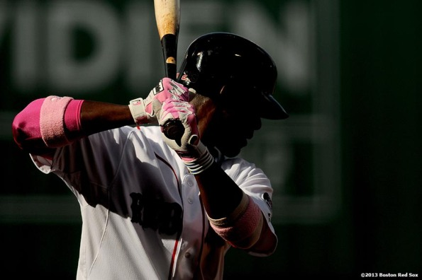 """Boston Red Sox infielder Pedro Ciriaco takes practice swings during the the ninth inning of a game against the Toronto Blue Jays Sunday, May 12, 2013 at Fenway Park in Boston, Massachusetts."""
