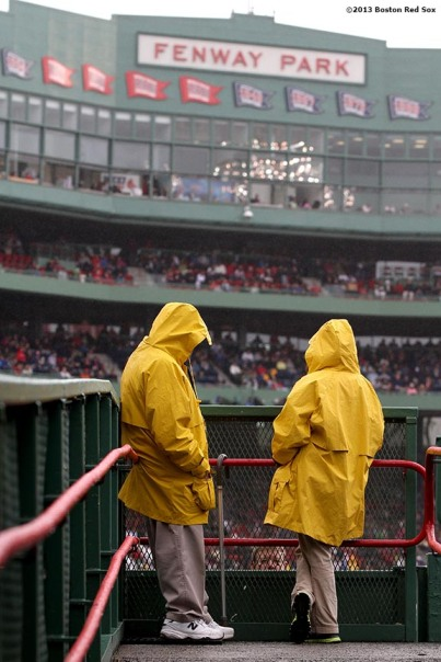 """Ushers stand in the right field bleacher section during a game between the Boston Red Sox and the Cleveland Indians at Fenway Park in Boston, Massachusetts Saturday, May 25, 2013."""
