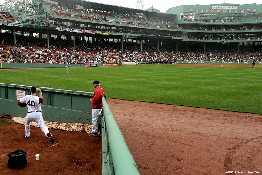 """Boston Red Sox closer Andrew Bailey warms up in the bullpen during a game against the Cleveland Indians at Fenway Park in Boston, Massachusetts Saturday, May 25, 2013."""