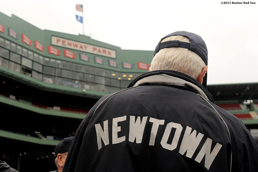 """A resident of Newtown, Connecticut walks on the field at Fenway Park in Boston, Massachusetts Saturday, May 25, 2013. The Boston Red Sox recognized Connecticut day by inviting residents of Newtown and members of Sandy Hook Elementary School down to the field to take photos and interact with both Red Sox and Cleveland Indians players and coaches."""