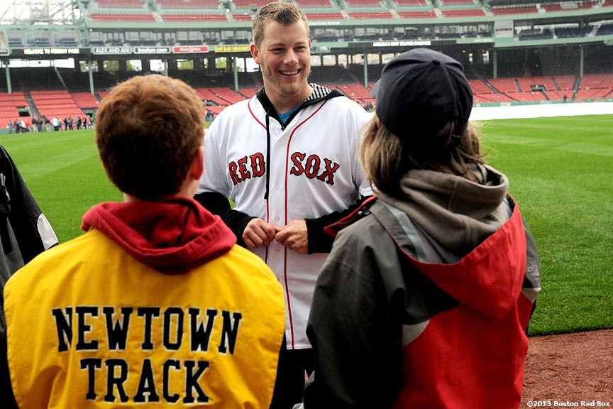 """Boston Red Sox pitcher Andrew Bailey speaks with residents of Newtown, Connecticut at Fenway Park in Boston, Massachusetts Saturday, May 25, 2013. The Boston Red Sox recognized Connecticut day by inviting residents of Newtown and members of Sandy Hook Elementary School down to the field to take photos and interact with both Red Sox and Cleveland Indians players and coaches."""