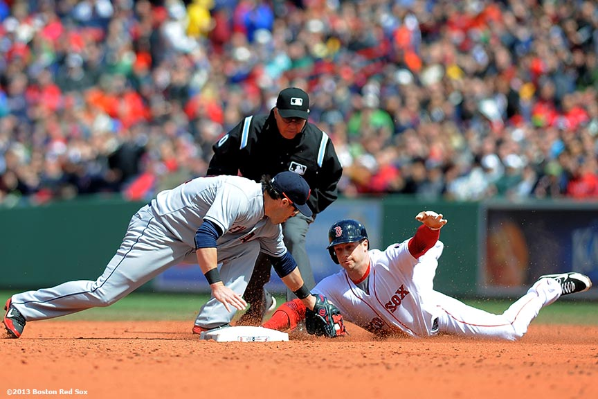 """Boston Red Sox outfielder Daniel Nava is tagged out by second baseman Jason Kipnes as he slides into second base after driving in a run during the third inning of a game against the Cleveland Indians at Fenway Park in Boston, Massachusetts Sunday, May 26, 2013."""