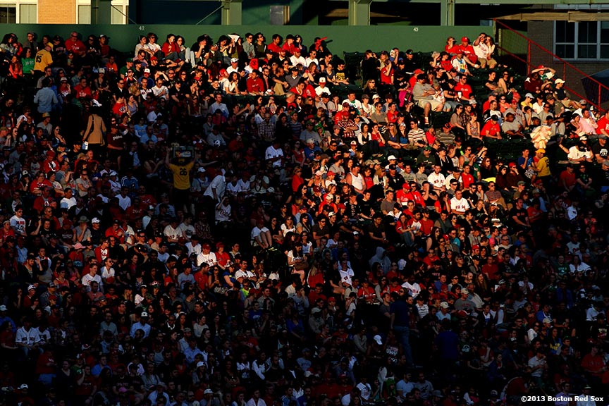 """Fans are shown in the right field bleachers as the sun sets during a game between the Boston Red Sox and the Philadelphia Phillies at Fenway Park in Boston, Massachusetts Monday, May 27, 2013."""